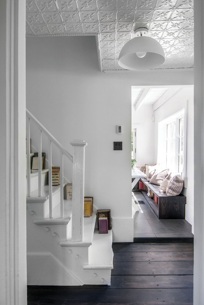 Inspiration for a mid-sized scandinavian painted straight staircase remodel in Montreal with painted risers