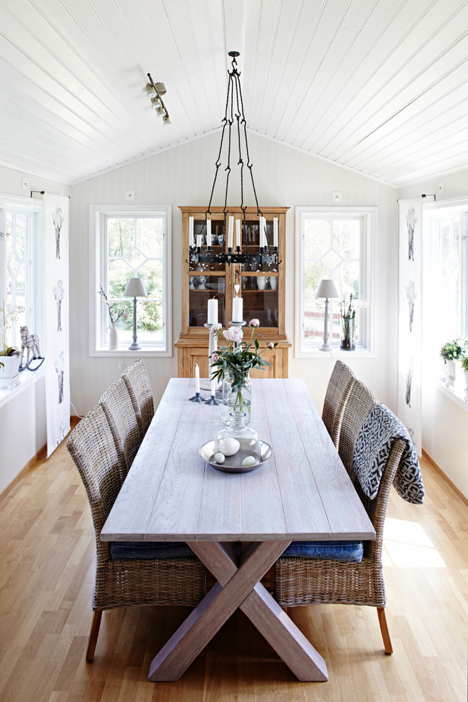 Mid-sized country light wood floor dining room photo in Bremen with white walls