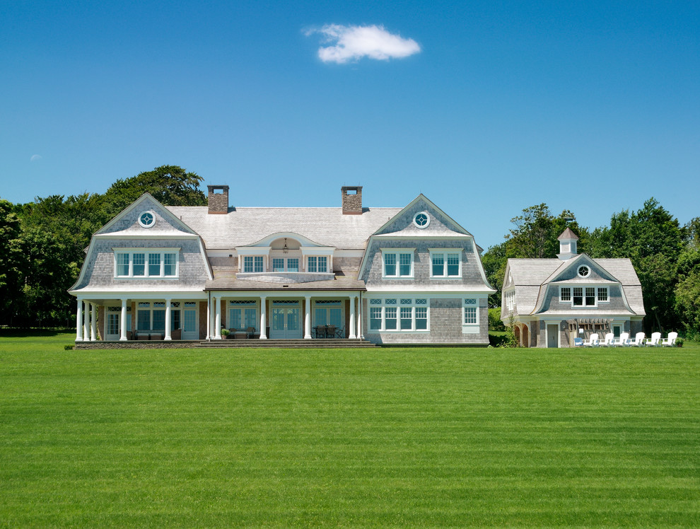 Victorian two-story wood exterior home idea in Providence with a gambrel roof