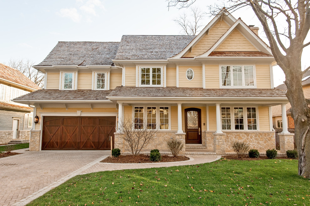 Inspiration for a timeless wood exterior home remodel in Chicago