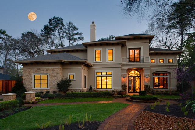 Large Tuscan Beige Two Story Stucco Exterior Home Photo In Houston With A  Hip Roof