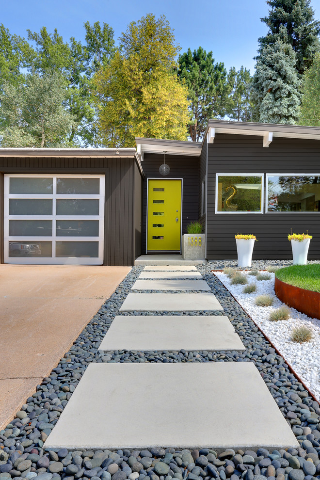 Mid-century modern gray one-story exterior home photo in Denver