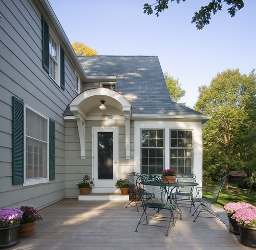 The Red Door Really Stands Out Thanks To Plain Wood And Adding A Little Matching Planter In Front Shows How Bring House Design Outside Of