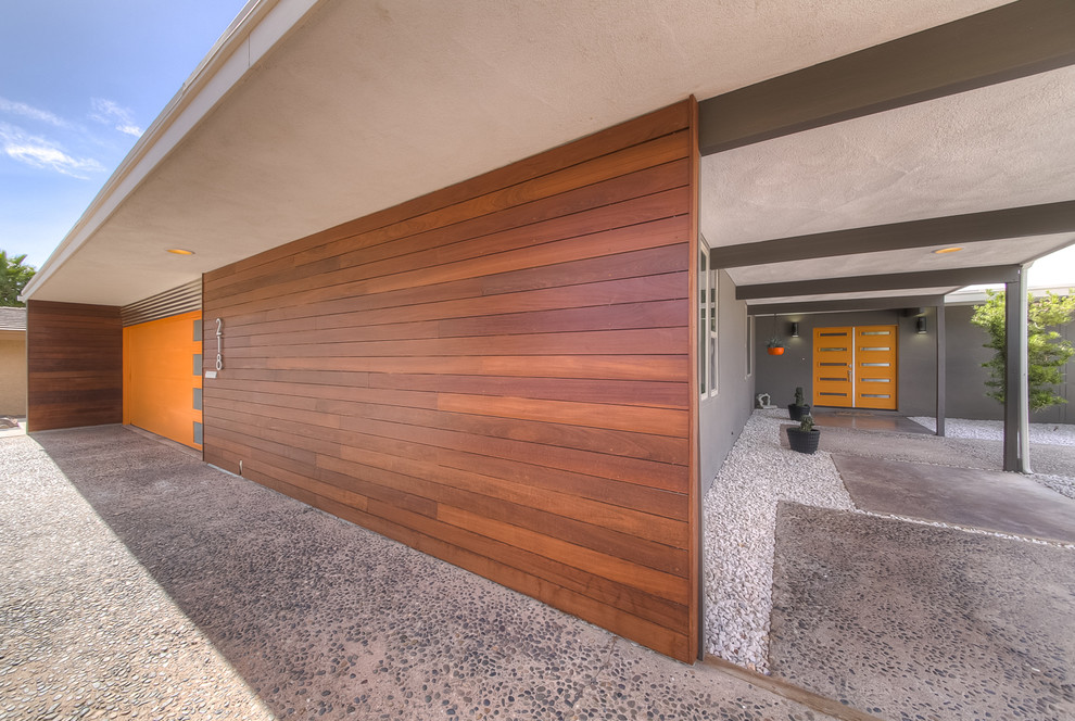 Inspiration for a 1960s gray one-story house exterior remodel in Las Vegas
