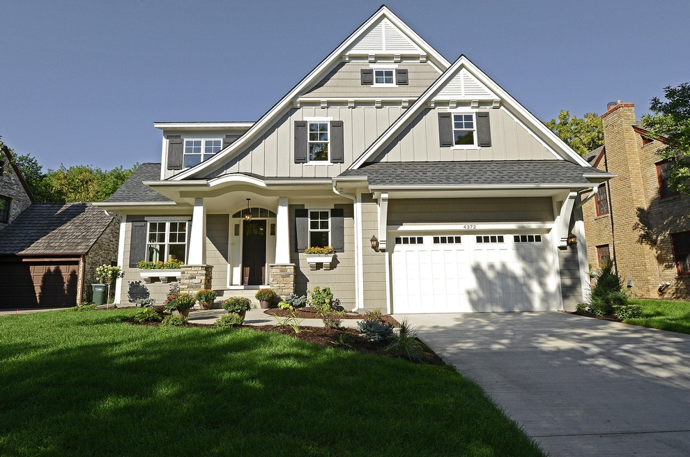 Traditional gray two-story exterior home idea in Minneapolis