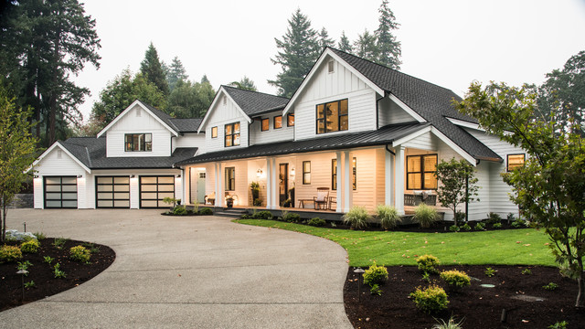 Inspiration for a cottage white two-story exterior home remodel in Seattle with a shingle roof