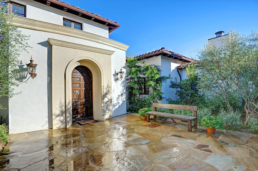 Mediterranean stucco exterior home idea in Los Angeles