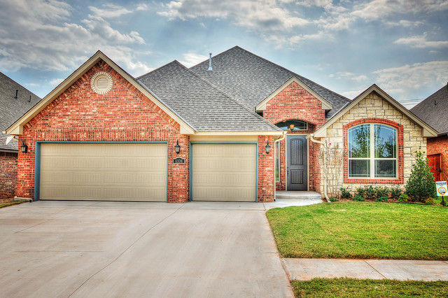 3 Car Garage With Brick Stone Exterior Transitional