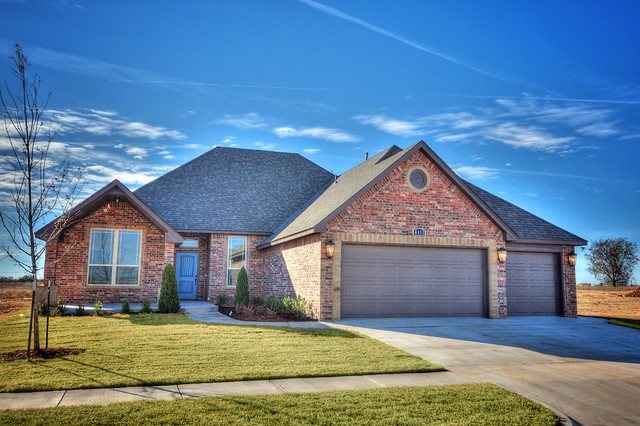 3 car garage with mix of brick and stone american for American brick and stone