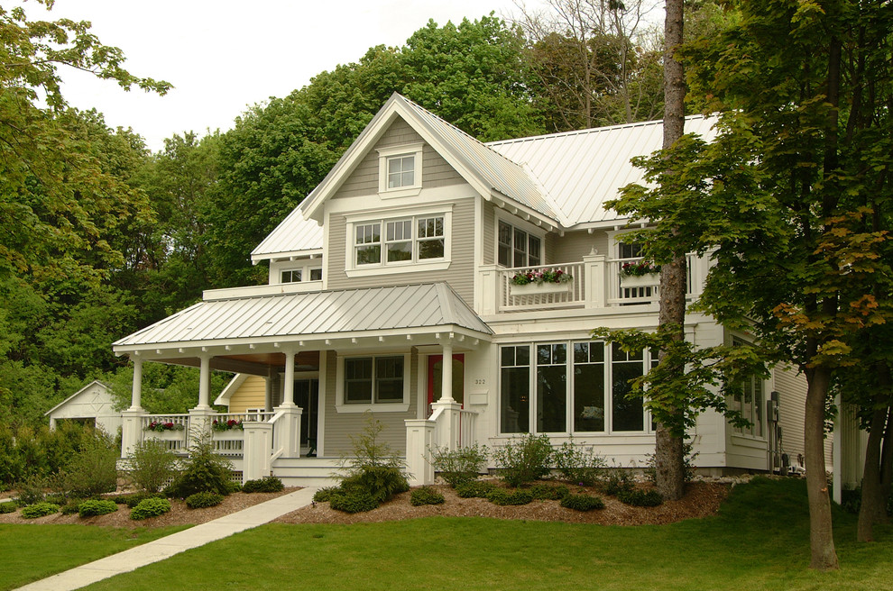 Inspiration for a timeless wood exterior home remodel in Grand Rapids with a metal roof