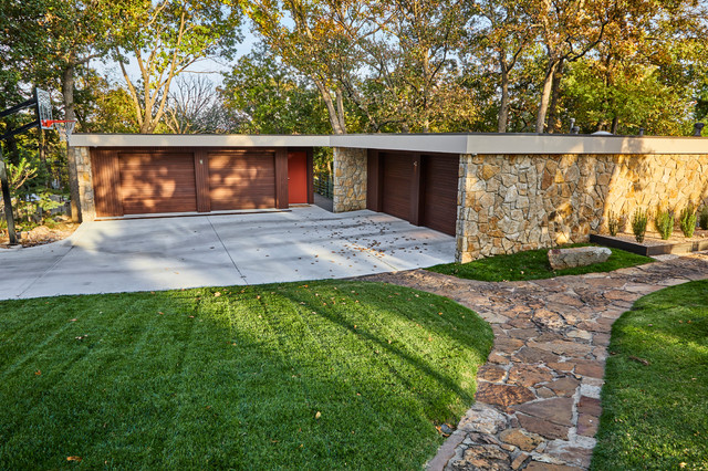 Inspiration for a mid-sized midcentury modern beige one-story mixed siding flat roof remodel in Other