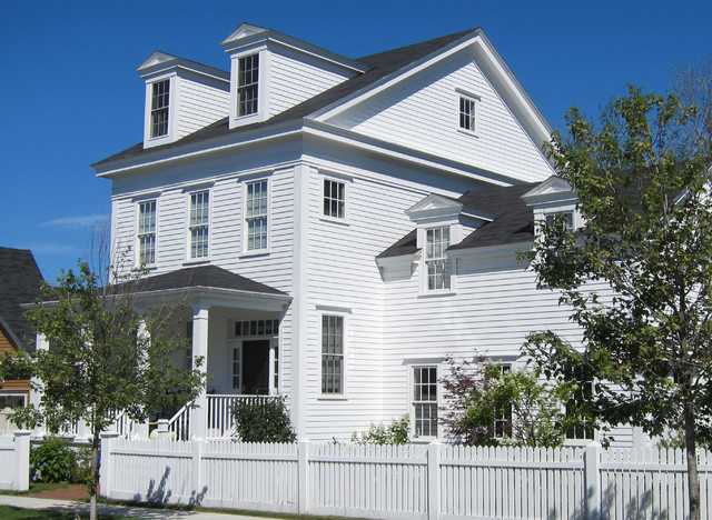 Inspiration for a timeless white two-story wood gable roof remodel in Portland Maine