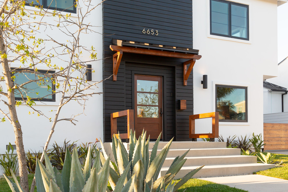 Transitional exterior home idea in Los Angeles