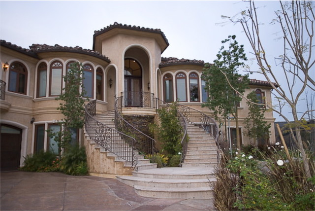 A custom home by mega builders mediterranean exterior Mediterranean custom homes