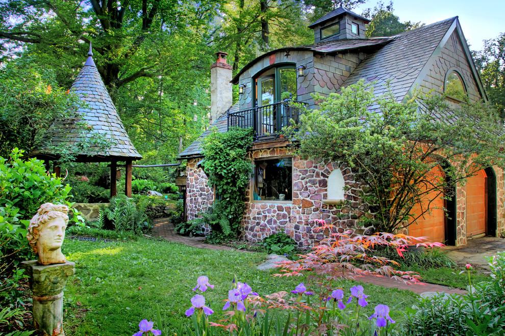 Example of a classic stone exterior home design in Philadelphia