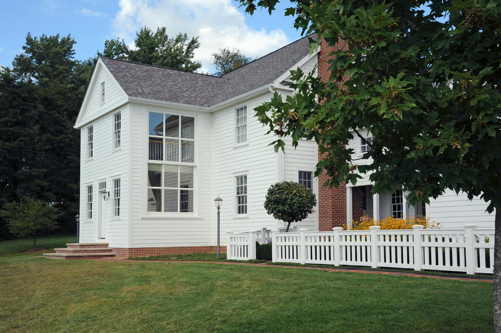 Mid-sized cottage white three-story wood gable roof idea in Columbus