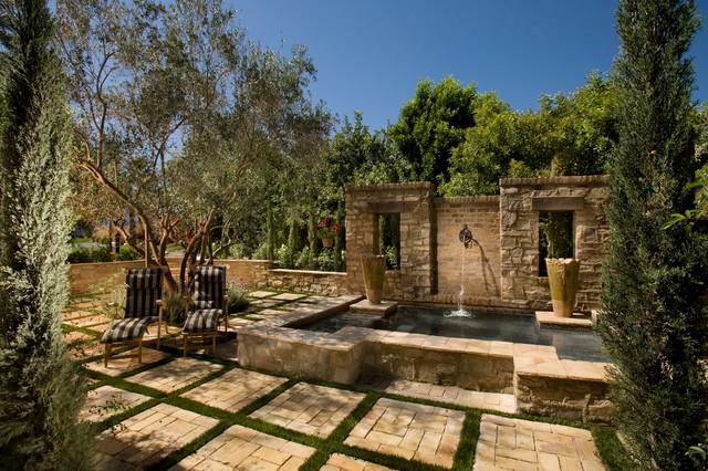 A tuscan farmhouse 1 mediterranean exterior orange for Tuscan courtyard landscaping