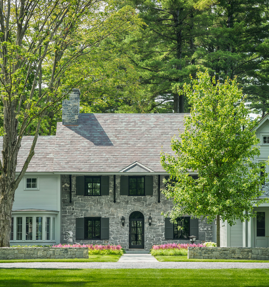 Inspiration for a farmhouse gray two-story mixed siding exterior home remodel in Burlington with a shingle roof
