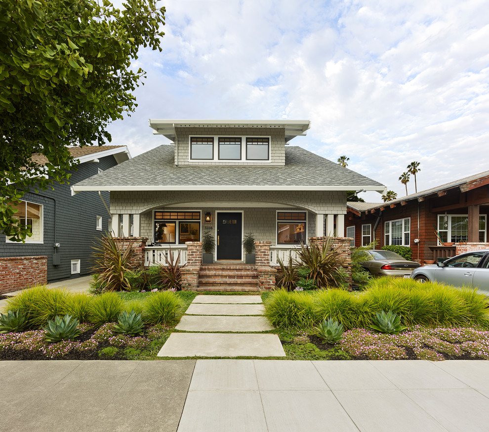 Inspiration for a craftsman gray two-story house exterior remodel in San Francisco with a hip roof and a shingle roof