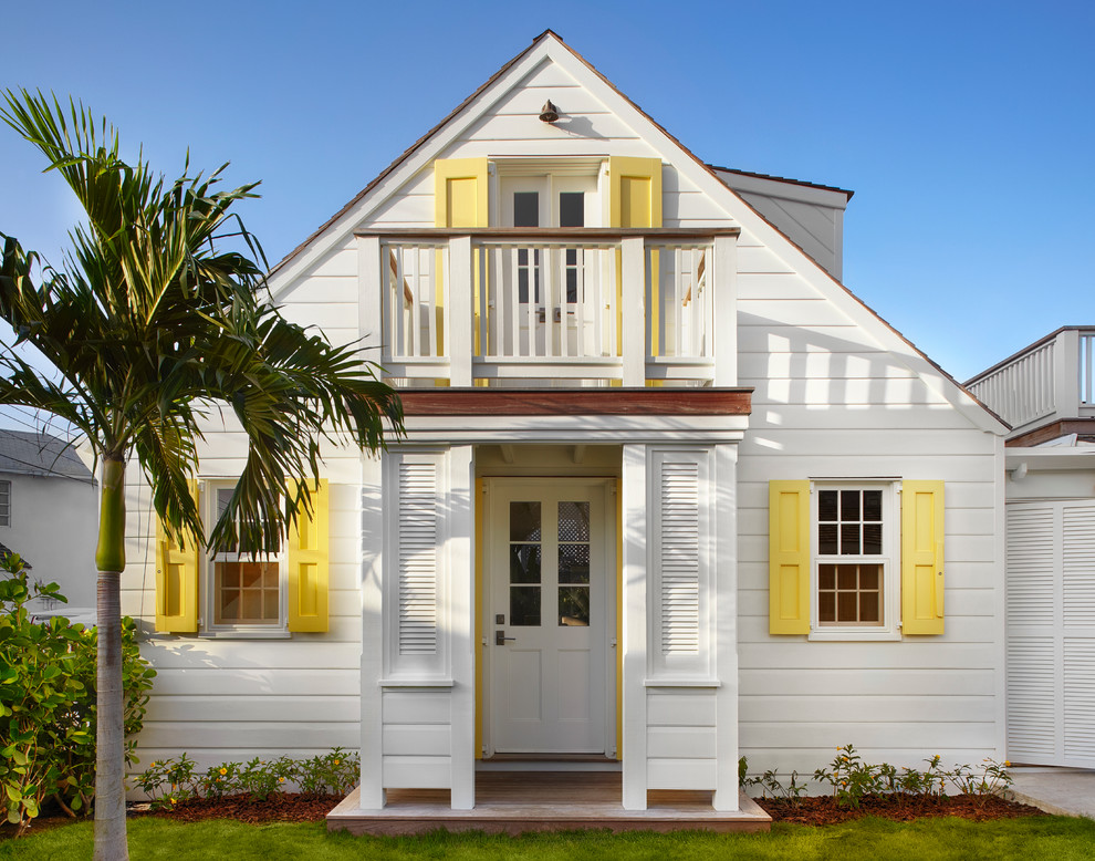 Beach style white two-story wood gable roof photo in Toronto