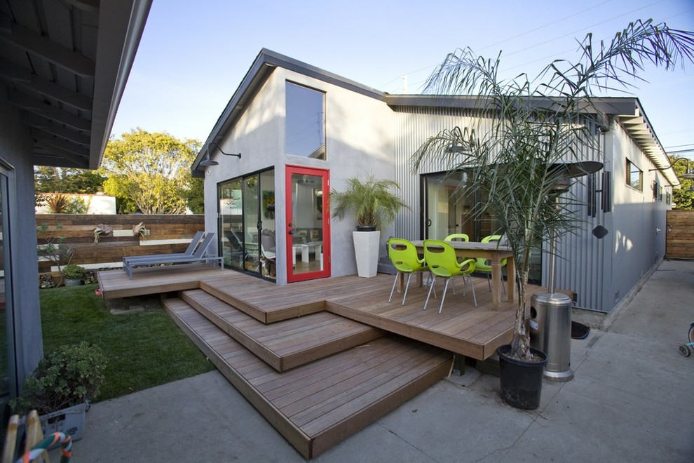 Inspiration for a contemporary mixed siding exterior home remodel in Los Angeles