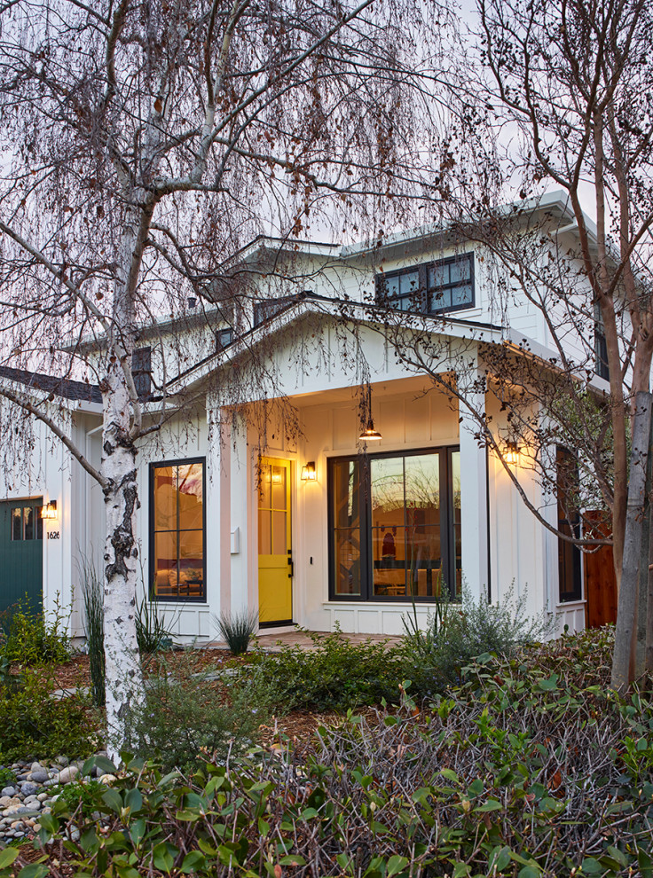 Large country white two-story wood house exterior idea in San Francisco with a shingle roof