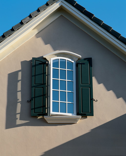 Arch top casement window with white aluminum cladding for Exterior window casement design