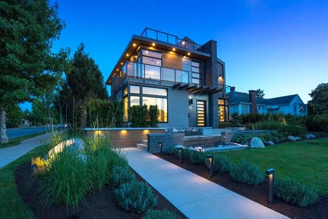 Mid-sized contemporary gray three-story mixed siding exterior home idea in Vancouver