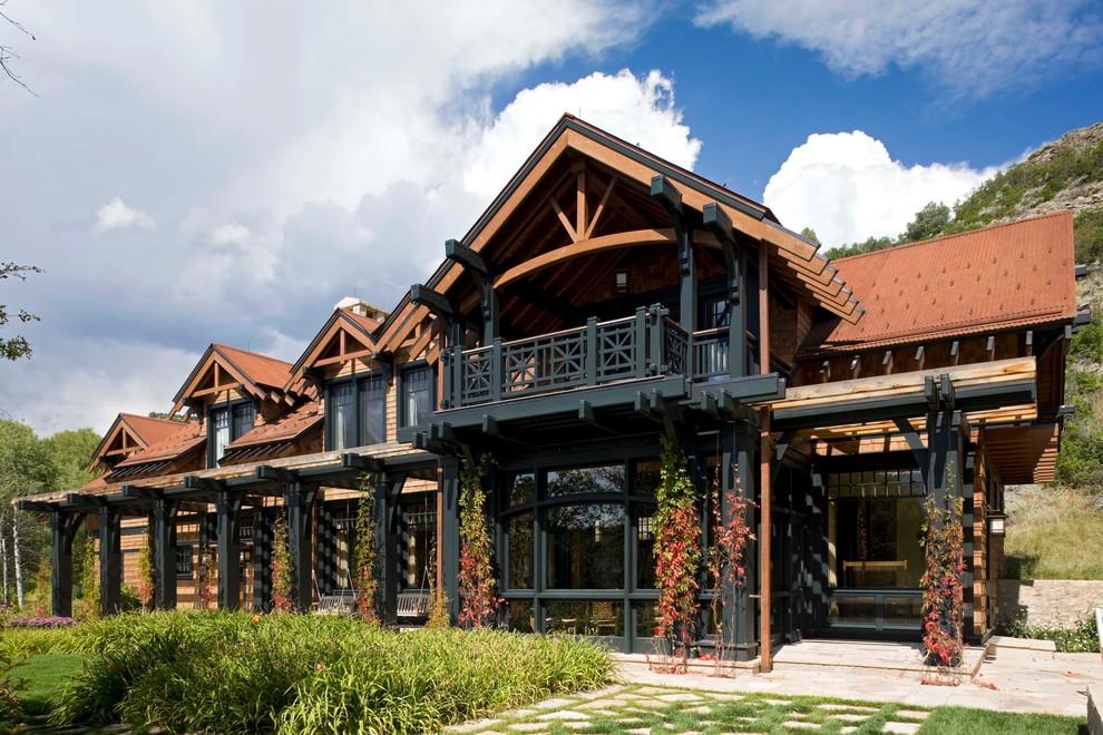 Large mediterranean beige two-story wood gable roof idea in Denver