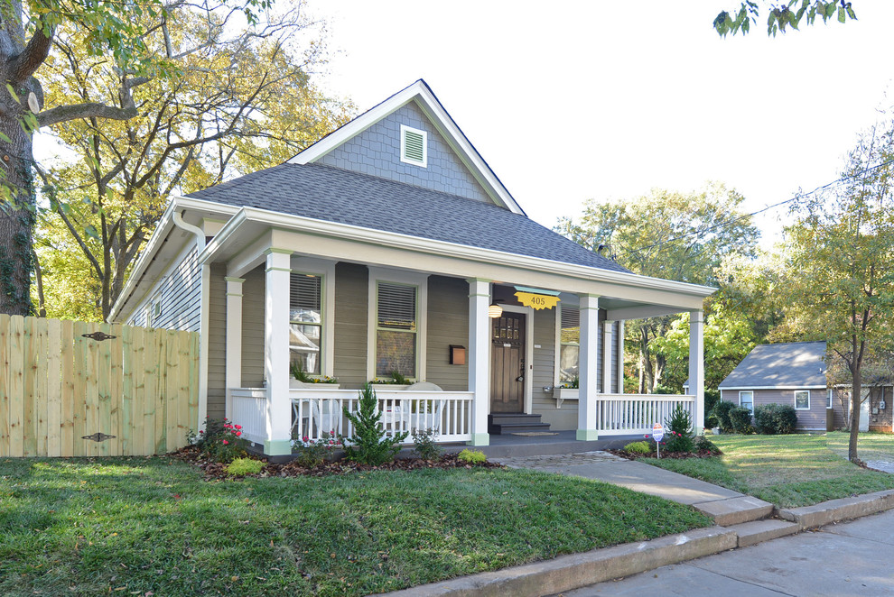 Inspiration for a small timeless gray one-story wood house exterior remodel in Atlanta with a hip roof and a shingle roof