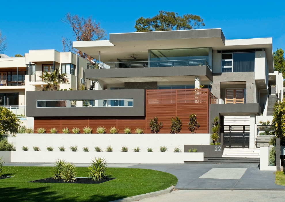 Huge contemporary three-story flat roof idea in Perth