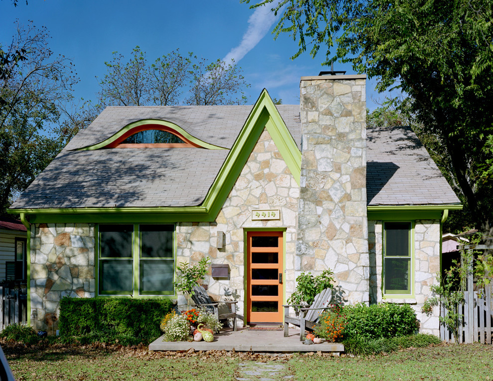 Inspiration for a timeless stone gable roof remodel in Austin