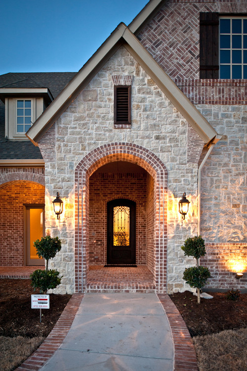 Lovely home do you know the name of this brick and stone for Brick traditional homes