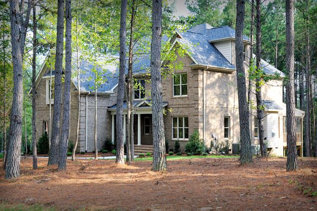 Farmhouse Brick Exterior Home Idea In Raleigh