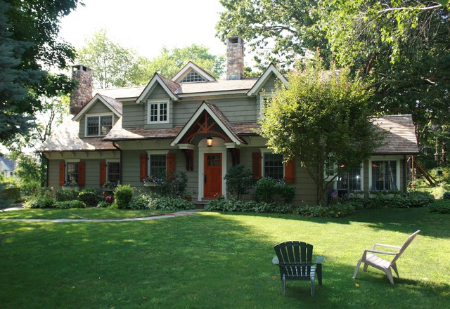 Award winning cape cod renovated into craftsman style home for Landscaping for cape cod style houses