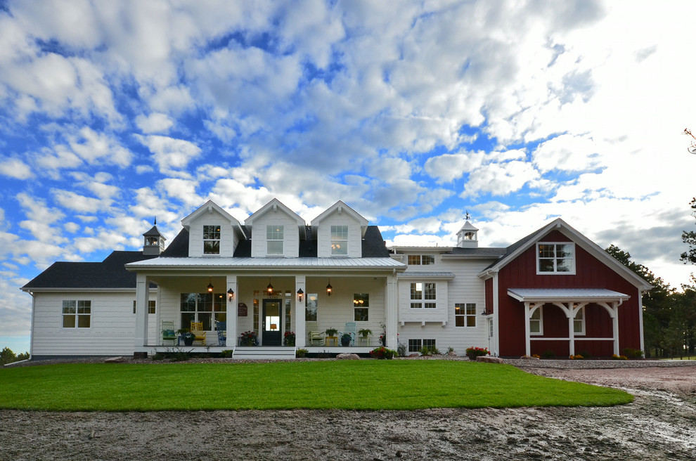 Large farmhouse white two-story gable roof idea in Cleveland