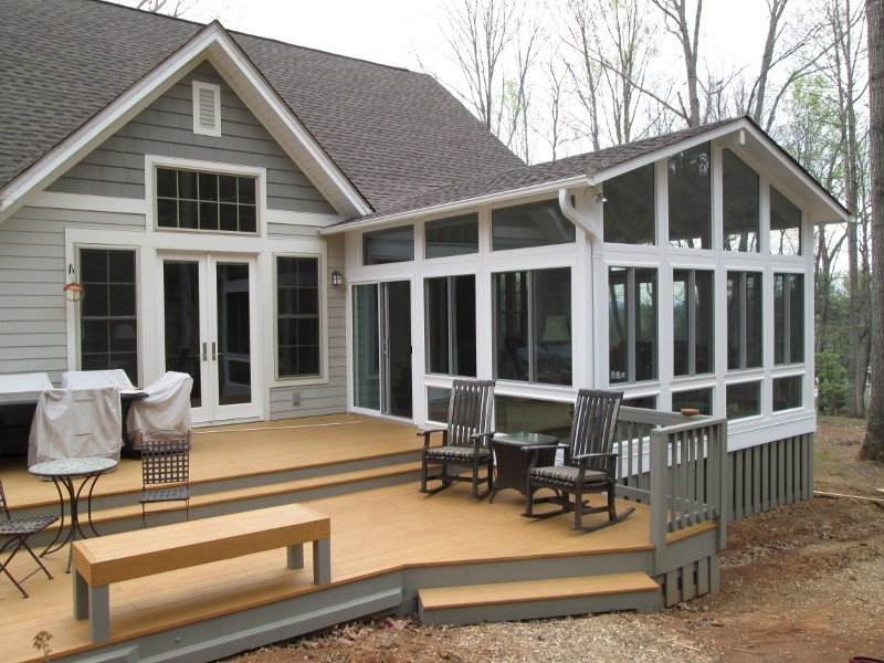 Example of a large classic gray one-story mixed siding exterior home design in Other with a shingle roof