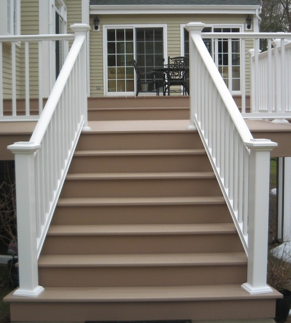Azek composite deck in brownstone and railings in white for Composite decking sale