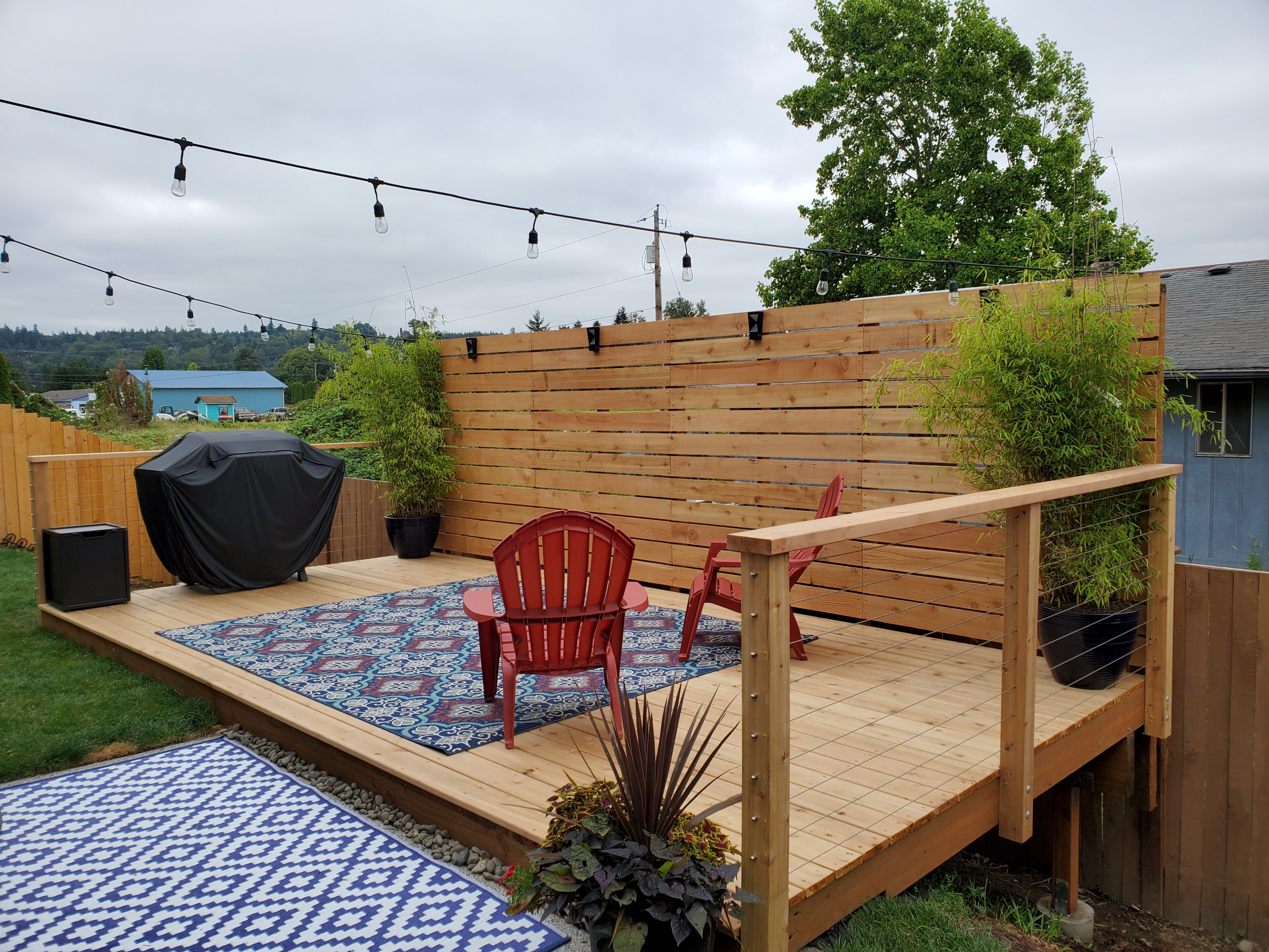 backyard deck with privacy fence/ with a low fence
