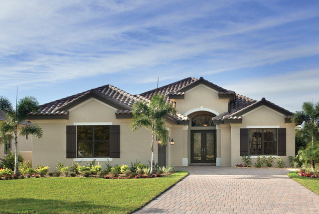 example of a tuscan exterior home design in tampa - Desert Home Exterior Designs