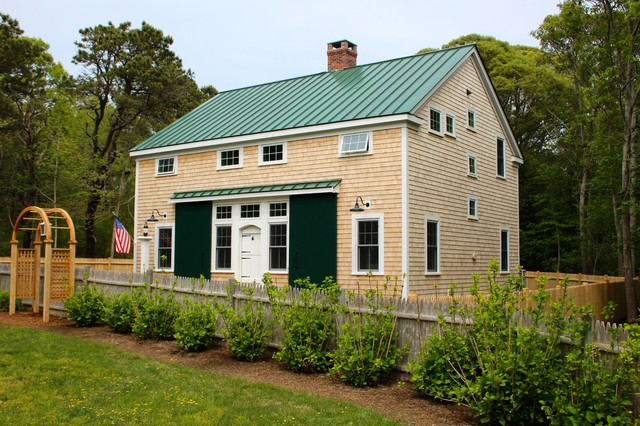 Example of a mid-sized eclectic beige two-story vinyl exterior home design in Boston with a metal roof