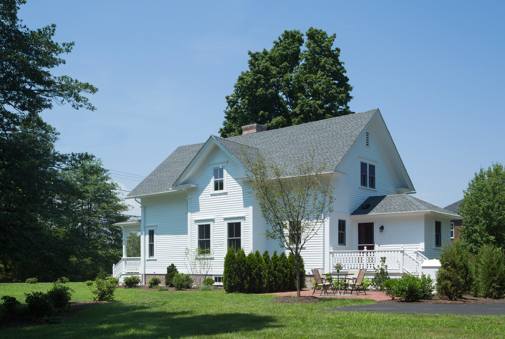 Cottage white two-story exterior home idea in Providence