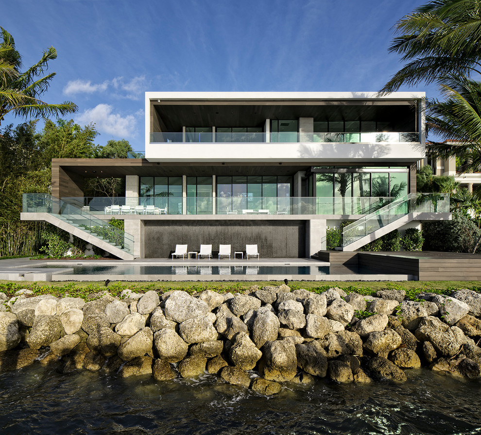 Inspiration for a large modern multicolored three-story mixed siding exterior home remodel in Miami