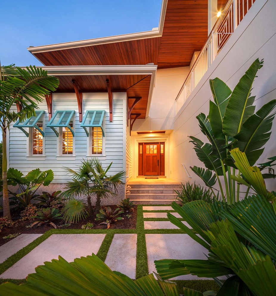 Island style white exterior home photo in Tampa