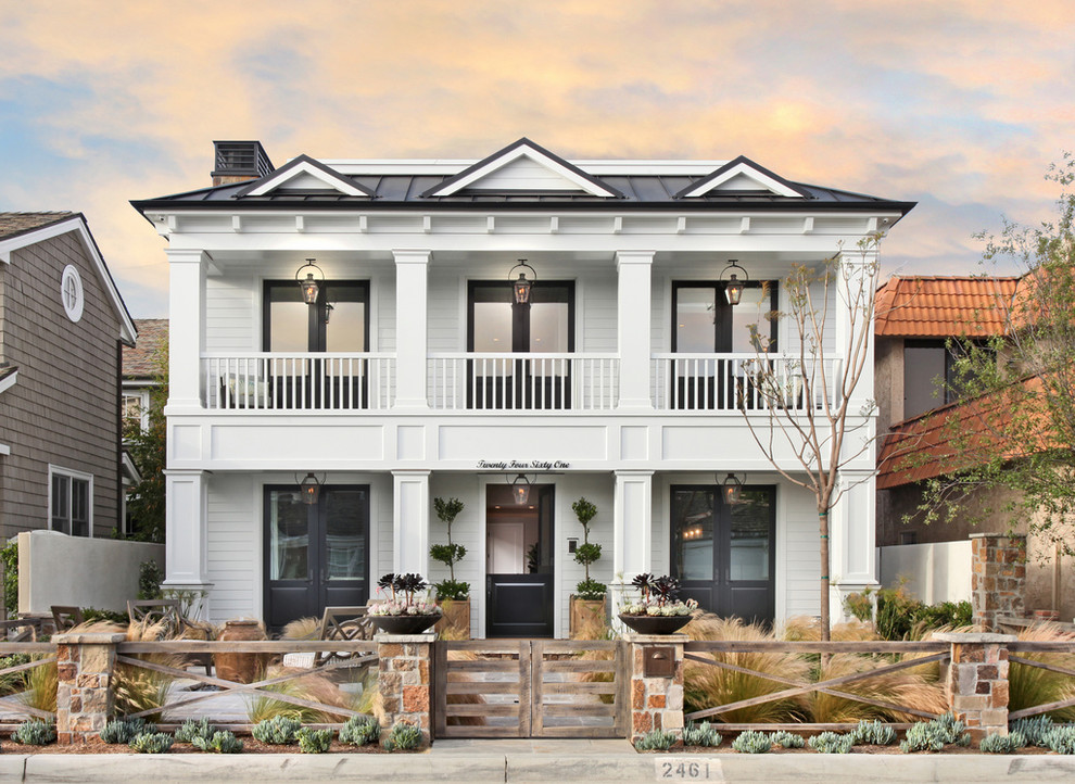 Example of a mid-sized transitional white two-story wood exterior home design in Orange County
