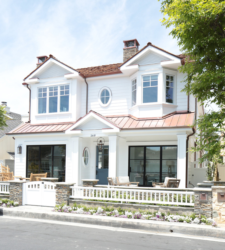 Inspiration for a large coastal white three-story exterior home remodel in Orange County