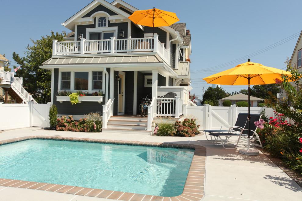 Small coastal two-story exterior home idea in Philadelphia