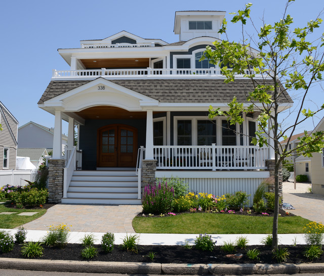 Beach House Exterior: Beach House Front Elevation Features Double Front Doors