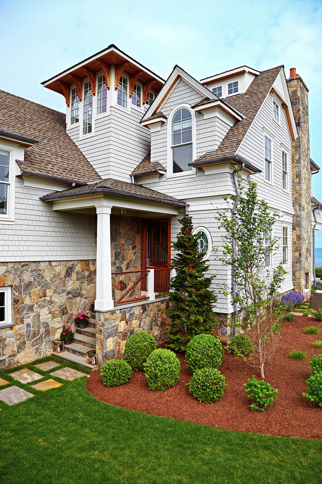 Inspiration for a large coastal gray three-story mixed siding exterior home remodel in New York