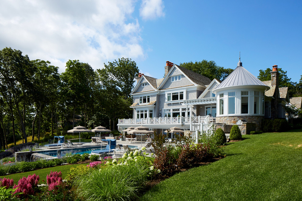Coastal gray three-story wood exterior home idea in New York with a mixed material roof